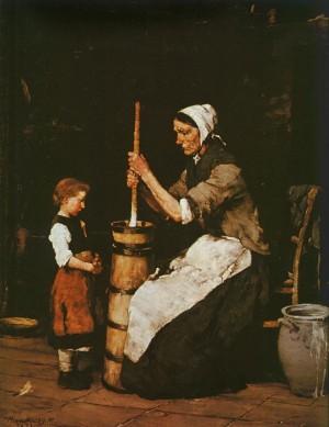 Жінка, яка збиває масло