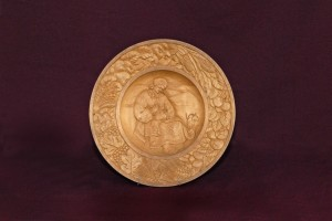 Hutsul Girl, (Embroidereress), 1947, decorative plate, wood, carving, bas-relief